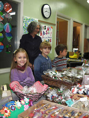 Courtesy photo. From left, are Bloomington Montessori School students Braelyn FitzSimmons, Aidan Ball and Cyrus Visser. Also shown is head teacher Amy Lifton.